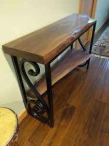 Inspired from a desire for a live edge accent table.  We worked with the musicality in the design!